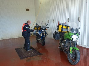 Dave washes his dirty bike.